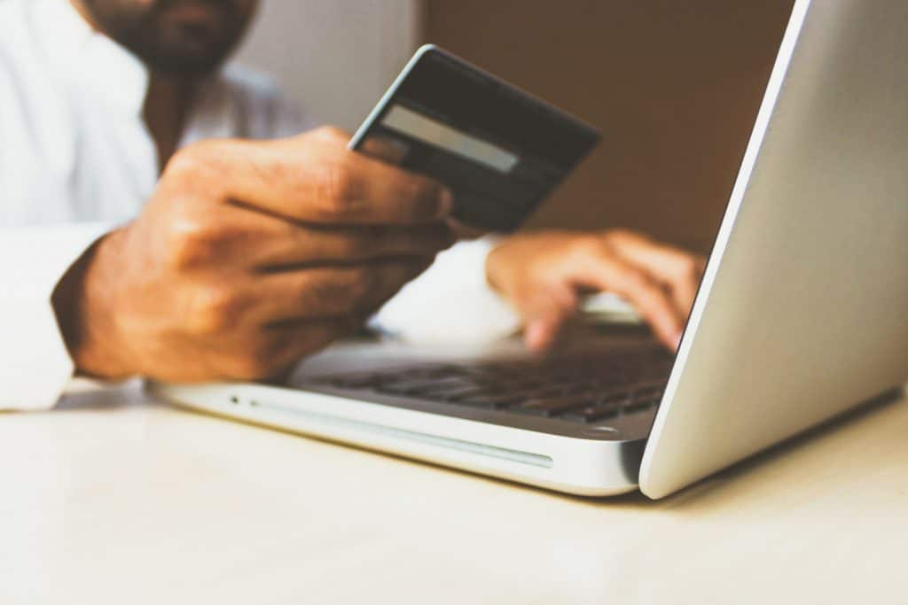 e-commerce customer entering his credit card info on a laptop computer